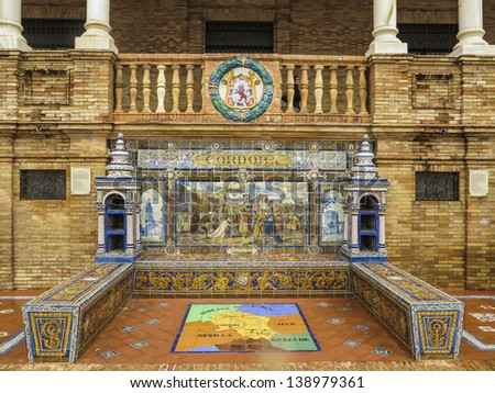 Ceramic bench on the Plaza de Espana in Sevilla, Spain with a historic  depiction of Cordoba . Built in 1928 for the Ibero-American Exposition of 1929. - stock photo