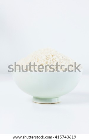Ceramic bowl containing rice,shallow Depth of Field,Focus on rice.