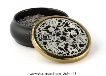 Ceramic bowl filled with dried lavender florets, with needlepoint lace inset in the lid - isolation on white. - stock photo