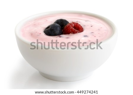 Ceramic bowl of fruit yogurt with berries isolated on white background.