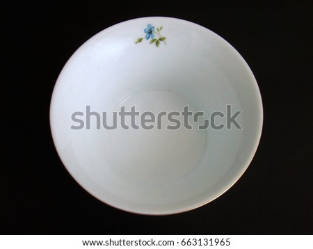 Ceramic bowl on black background