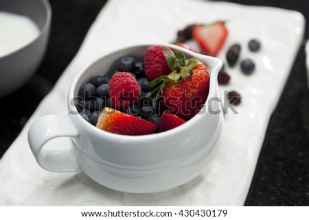 ceramic bowl with assortment berries blueberries, strawberries and blackberries