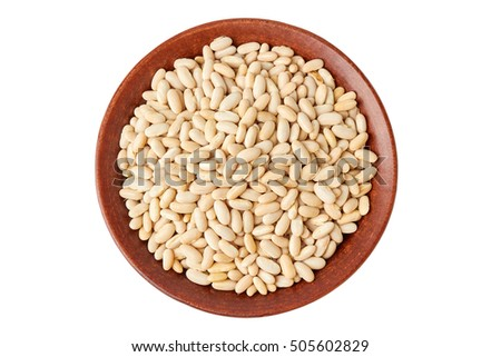 Ceramic bowl with canellini beans on white