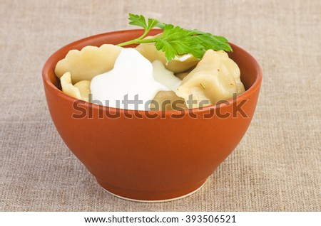 Ceramic bowl with meat dumpling (focus point - lower part of bowl) - stock photo