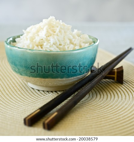 ceramic bowl with plain white rice - stock photo