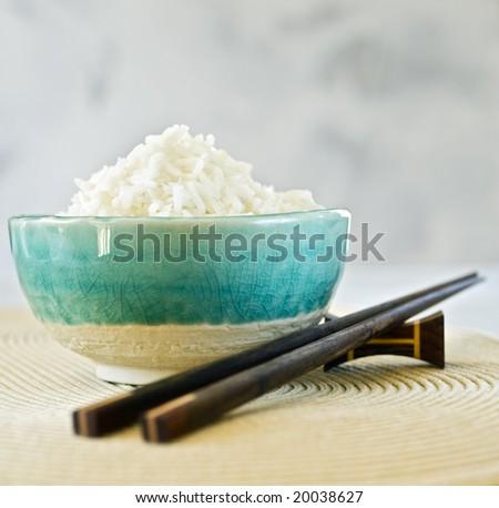 ceramic bowl with plain white rice - stock photo