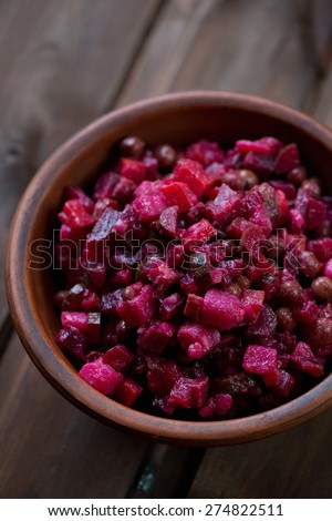 Ceramic bowl with russian traditional vinaigrette salad, close-up - stock photo