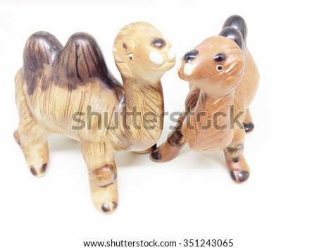 Ceramic camel on a white background. A souvenir.