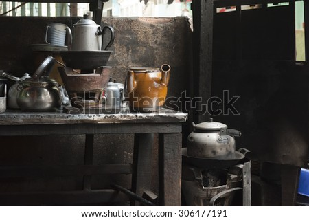 Ceramic coal stove with the metallic and ceramic pots - stock photo