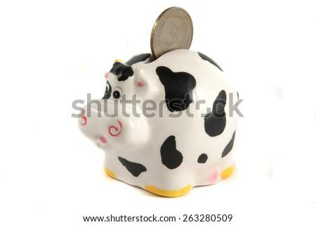 ceramic cow isolated on white background - stock photo