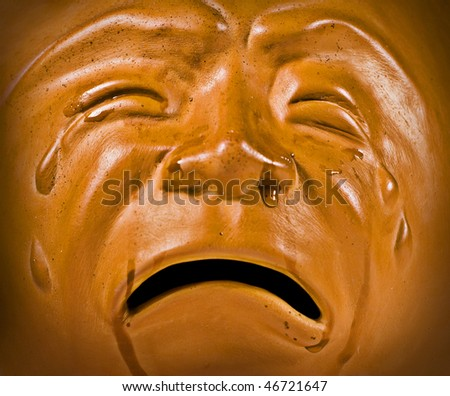 Ceramic Crying Face with real tears - stock photo