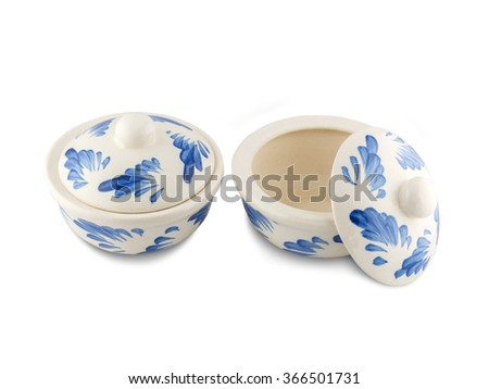 Ceramic cups on white background