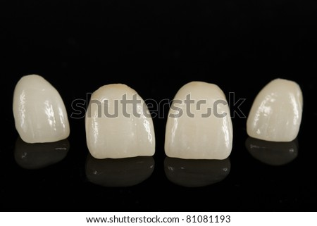 ceramic dental crowns, metal free / front view - stock photo