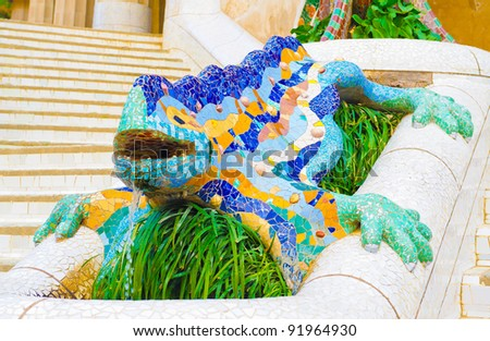 Ceramic dragon fountain at Parc Guell designed by Antoni Gaudi, Barcelona, Spain. - stock photo