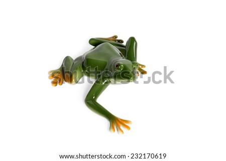 Ceramic figurine green frog crawling isolated on white background - stock photo