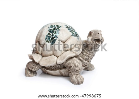 Ceramic figurine of turtle on white background