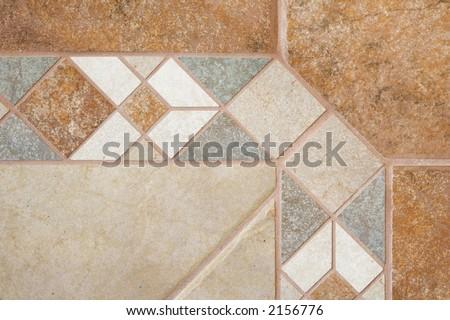 Ceramic floor tile border and field - stock photo