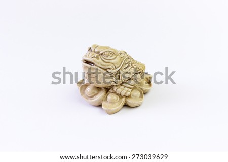Ceramic frog figurine. The symbol of financial success isolated on a white background - stock photo