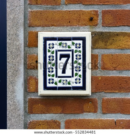Ceramic house number seven.