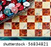 ceramic mosaic - fake marble and some stones - red, white, blue - sharpnes on the table - stock photo