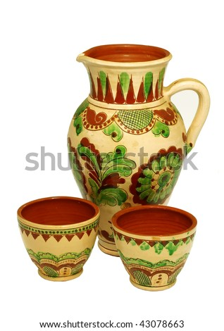 ceramic old jug and two cup with ornament isolated on white background