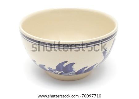 Ceramic painted bowl isolated on white background - stock photo
