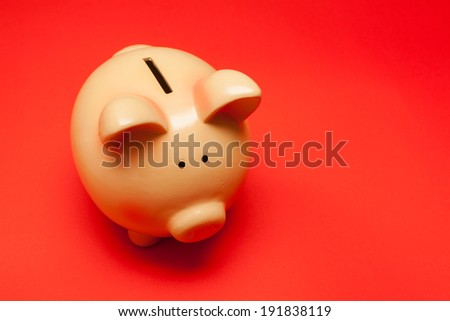 Ceramic Piggy Bank Savings on Red Background  - stock photo