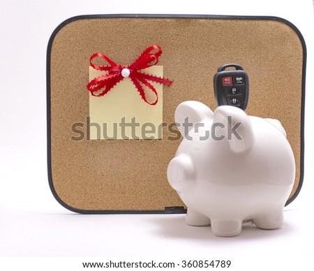 Ceramic piggy bank with car key  - stock photo