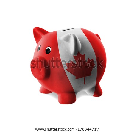 Ceramic piggy bank with painting of national flag, Canada - stock photo