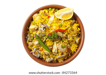 Ceramic plate with paella isolated on a white background - stock photo