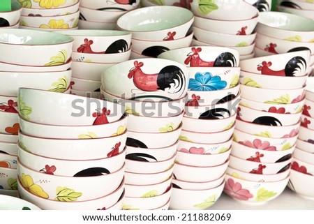Ceramic rooster bowl from Lampang on sell in local market,Thailand - stock photo