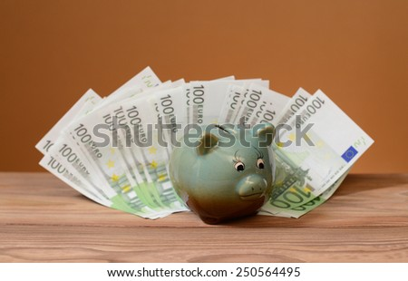 Ceramic safe storage of petty cash and bank notes on the table - stock photo