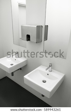 Ceramic Sink With Stainless Steel Accessories In Modern Washroom.Two Sinks  To European Public Toilet