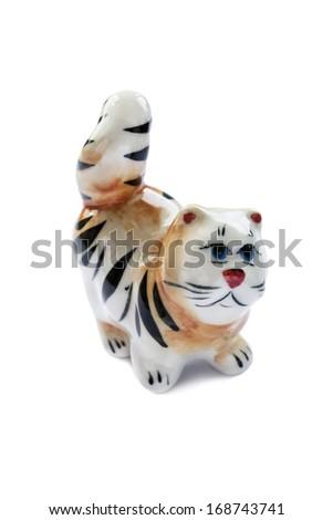 Ceramic souvenir figurine of tabby cat on white background - stock photo