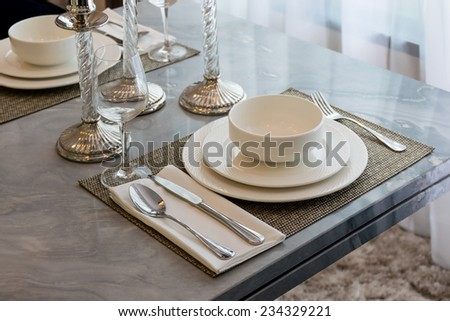 Ceramic tableware on the marble worktop - stock photo