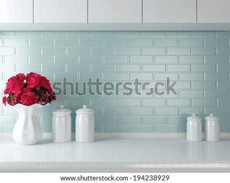 Ceramic tableware on the worktop. White kitchen design.