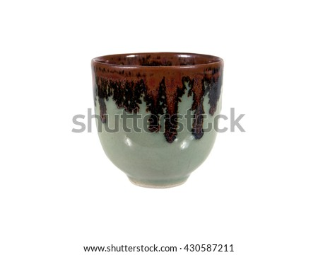 Ceramic tea cup with crackle glaze isolated on white background - stock photo