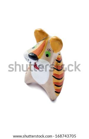 Ceramic  tiger isolated over white background - stock photo