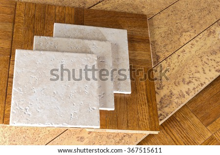 ceramic tile, cork and parquet wooden flooring samples for home interior remodel  - stock photo