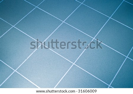 Ceramic tile floor blue color. Shallow DOF