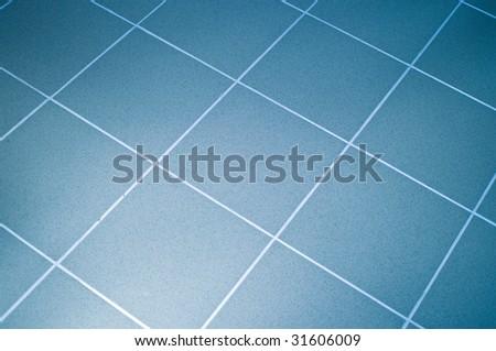 Ceramic tile floor blue color. Shallow DOF - stock photo