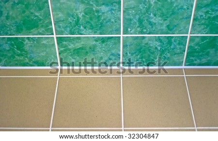 Ceramic tile floor brown and green color. Shallow DOF - stock photo