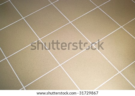 Ceramic tile floor brown color. Shallow DOF - stock photo