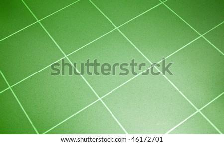 Ceramic tile floor green color. Shallow DOF - stock photo