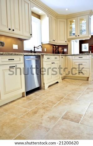 Ceramic tile floor in a modern luxury kitchen - stock photo