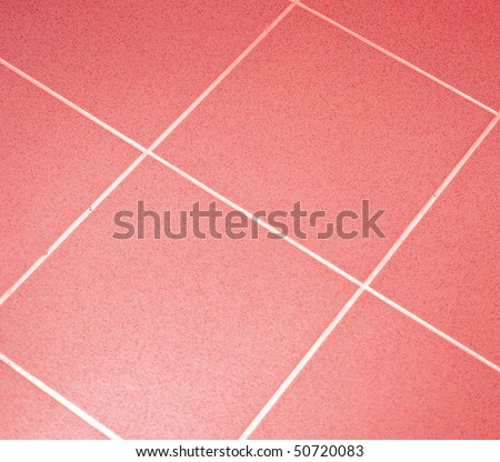 Ceramic tile floor red color. Shallow DOF - stock photo