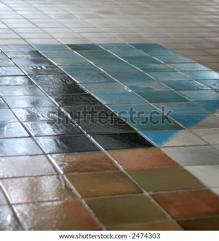 Ceramic tile floor with interesting pattern fading into the distance - stock photo