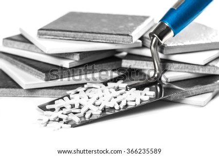 ceramic tiles and tools closeup on white background - stock photo