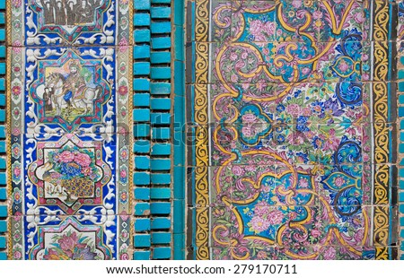 Ceramic tiles with traditional Persian patterns on the beautiful walls of the old mosque in Iran - stock photo