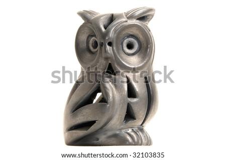 Ceramic toy owl - Isolated on white background - stock photo